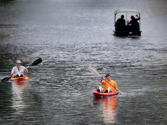 Matt Stout and his son Joshua enjoy a little kayaking