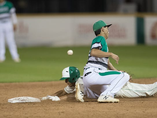 Bishop's Rammy Carrillo slides in to second as Banquete's