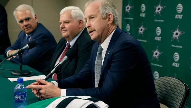 Dallas Stars NHL hockey team general manager Jim Nill, right, talks about hiring head coach Ken Hitchcock, center, with team president Jim Lites looking on during a news conference in Dallas on Thursday.
