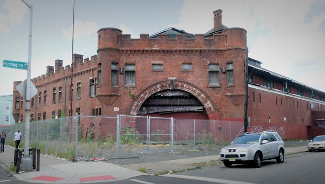 The Paterson armory, shown in 2013, stood vacant for decades before most of the building was destroyed in a fire in 2015. The historic façade is the only portion that remains.