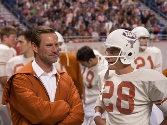 "Aaron Eckhart, left, portrays Darrell Royal and Finn Wittrock portrays Freddie Steinmark in ""My All-American."""