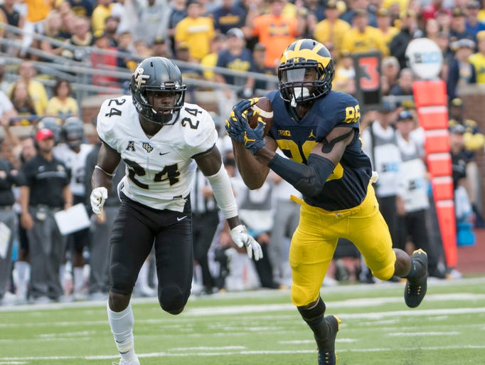 Michigan wide receiver Jehu Chesson makes a reception