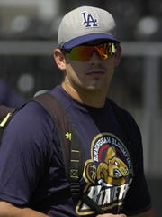 Forest Koumas, who played in the College World Series,