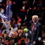 Republican vice presidential candidate Gov. Mike Pence of Indiana waves as confetti and balloons fall during celebrations after Republican presidential candidate Donald Trump's acceptance speech on the final day of the Republican National Convention in Cleveland, Thursday, July 21, 2016.