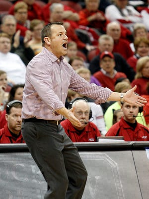 Louisville's coach Walz does not seem pleased with an official's call. Jan. 14, 2015