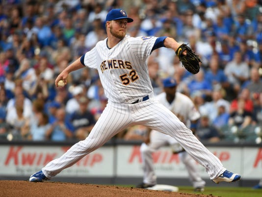 Milwaukee Brewers starting pitcher Jimmy Nelson winds up during the first inning of a baseball game against the Chicago Cubs on Friday, July 22, 2016, in Milwaukee. (AP Photo/Benny Sieu)