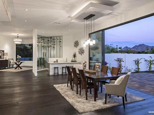 Thomas Daniels, a radiologist at the Mayo Clinic, and Alessandra Puggioni, current Chair of Vascular Surgery of Honor Health Osborn Medical Center, purchased thismansion in Paradise Valley's Lincoln Heights community.
