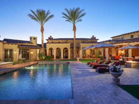 Charles Johnson and his wife, Shelley, purchased this mansion in Paradise Valley's Equestrian Trails community.