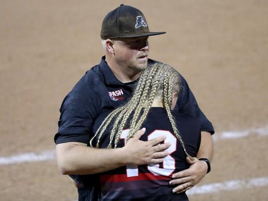 SPASH softball coach Tom Drohner comforts Aubrey Drohner after their loss to Kaukauna in the 2017 state softball tournament. The Panthers are 14-0 and ranked No. 2 behind a battery of four starting pitchers.
