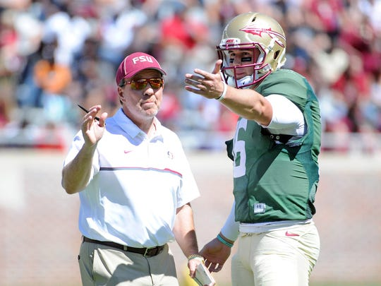FSU head coach Jimbo Fisher talks to quarterback JJ Cosentino (16) during the 2017 Spring Game at Doak Campbell Stadium.