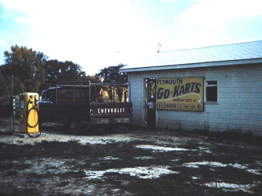 M & H Go-Karts in town of Mitchell, with a sign advertising Plymouth Go-Karts manufactured by Feldmann Manufacturing.