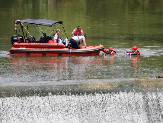 Rescue workers prepare the boat as they retrieve the
