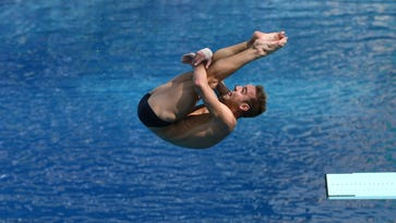 Two Indiana divers beat Purdue silver medalist Johnson; Hoosiers romping in Big Ten swimming