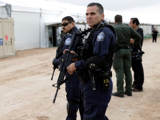 U.S. Customs and Border Protection agents stand outside