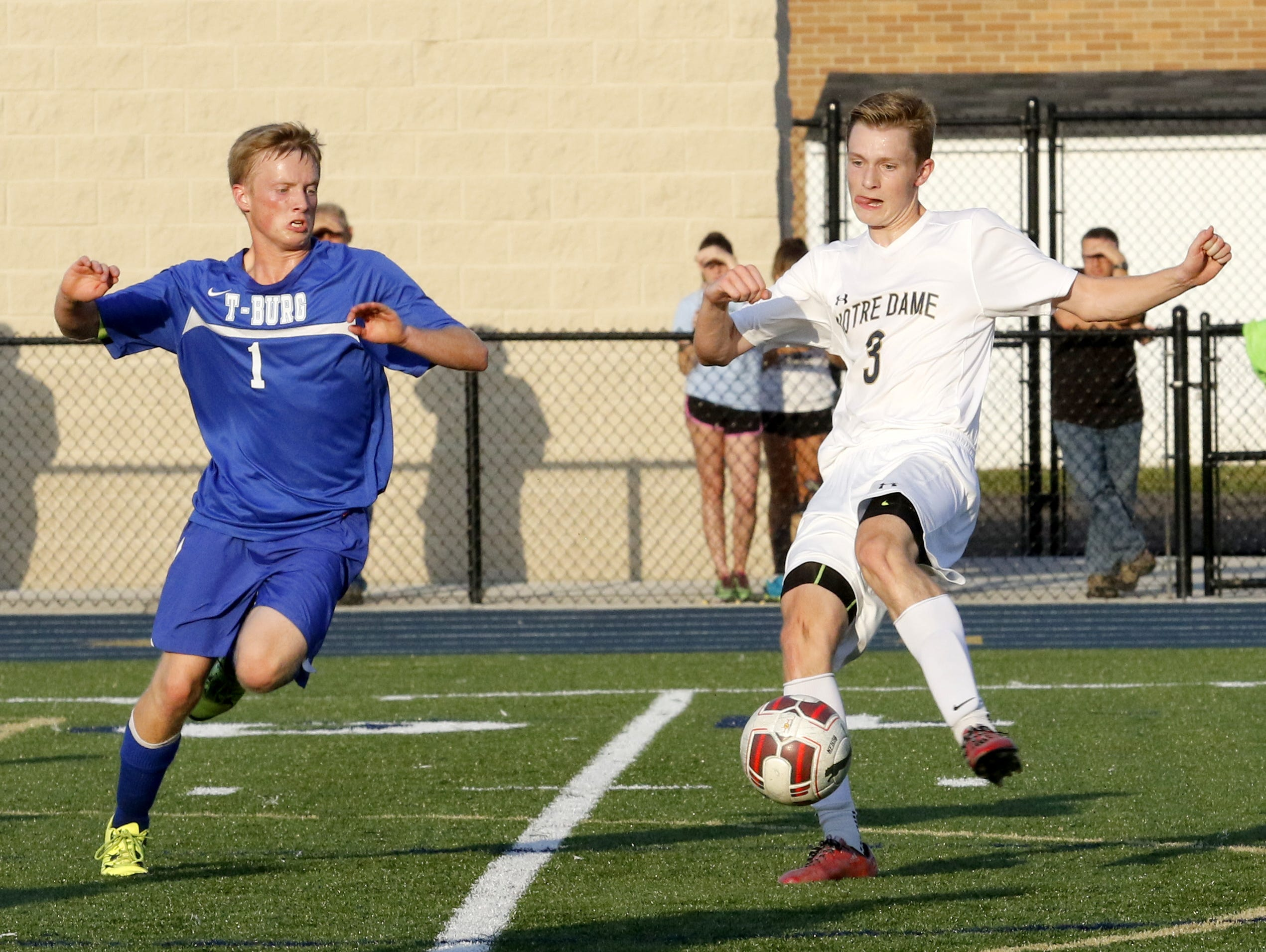 Alec Cutler of Notre Dame controls the ball as Danny Lapp of Trumansburg closes in Thursday during boys soccer at Brewer Memorial Stadium.
