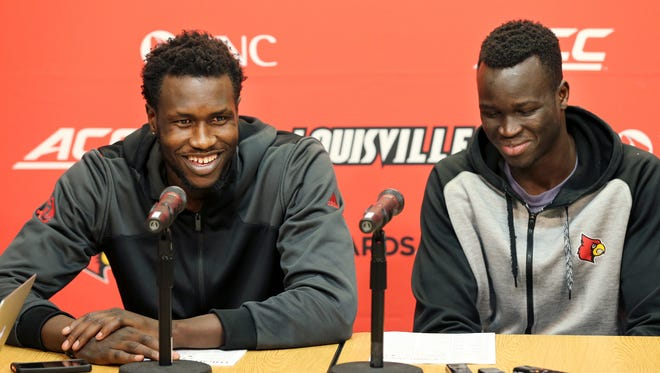 Louisville's Mangok Mathiang and Deng Adel apologize for missing the game against Virginia due to a disciplinary action. Mathiang and Adel missed curfew and were not allowed to travel with the team. 