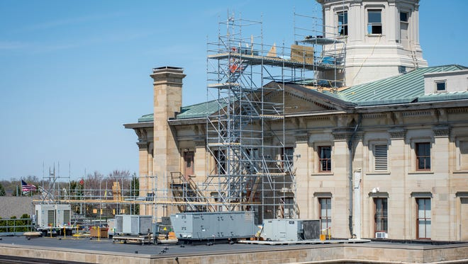 Crews work on making exterior repairs to the cupola of the U.S. Courthouse in Port Huron Tuesday, May 8, 2018. Repairs include replacing damaged wood, replacing the copper roof and repainting the base and other exterior elements of the cupola.