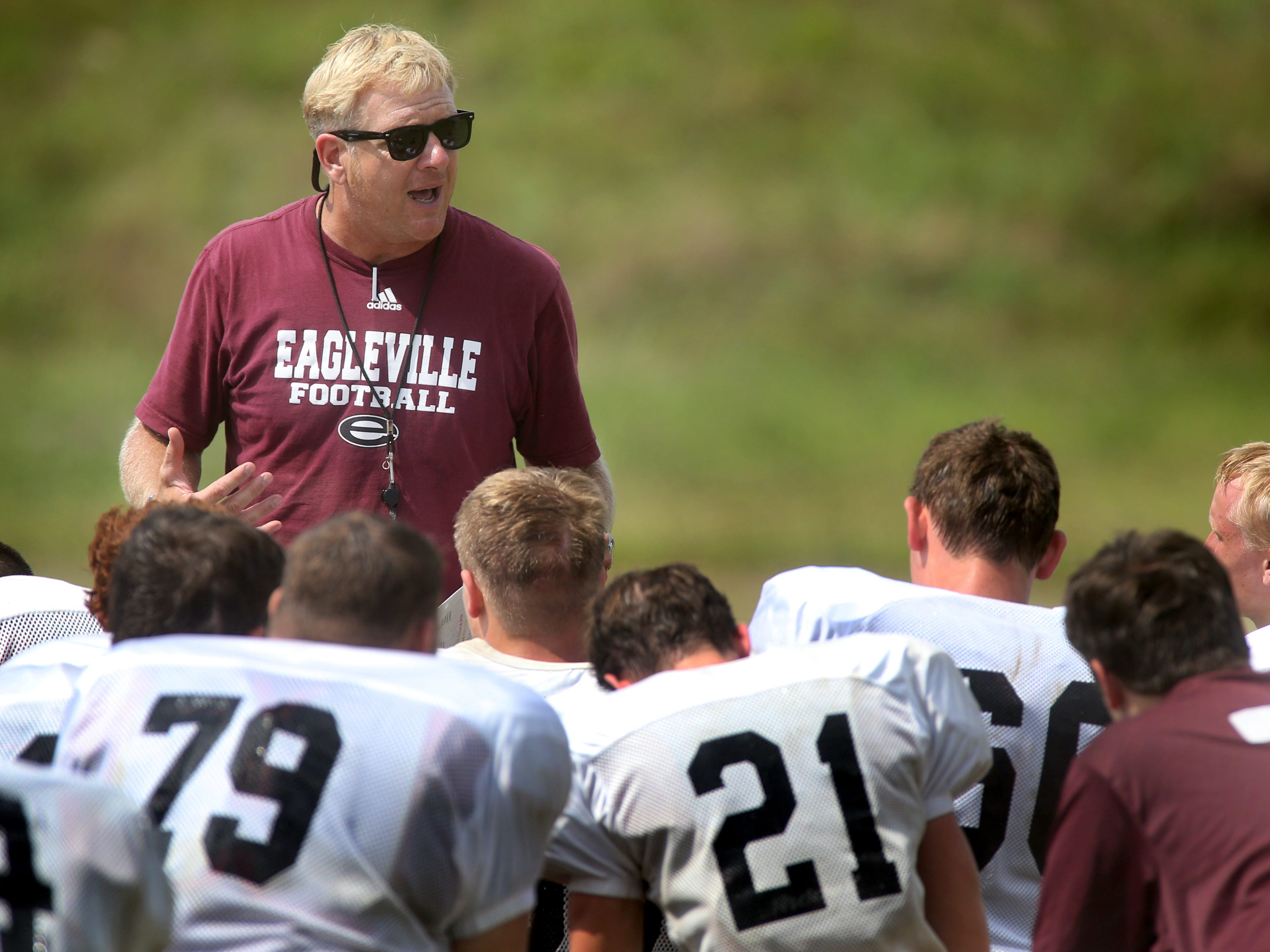Eagleville head coach Steve Carson talks with the football team after practice at the school, on July 22, 2014.