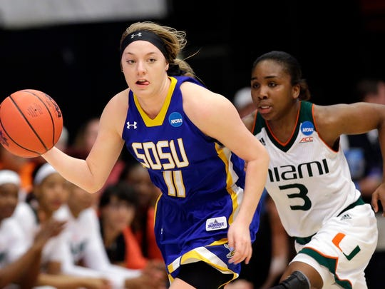 South Dakota State guard Madison Guebert (11) dribbles past Miami guard Jessica Thomas (3) in the second half of a first-round women's college basketball game in the NCAA Tournament Saturday in Stanford, Calif.  South Dakota State won 74-71.