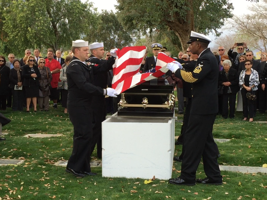 An honor guard detail from Navy Operational Support Center in Moreno Valley folds the flag during a service for Admiral Ben Montoya at the Coachella Valley Cemetery on Wednesday, Jan. 6, 2016.