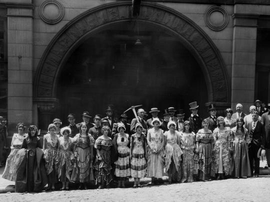 This July 1926 photo shows characters dressed in period attire outside of The Burnet House. They were part of ceremonies held by Union Central Life Insurance Co. to mark the razing of the historic hotel to make way for the company's new annex. Cincinnati Mayor Murray Seasongood, center, holds a pickaxe.