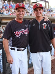 Al LeBoeuf poses with his son Mac at a Timber Rattlers game last summer.