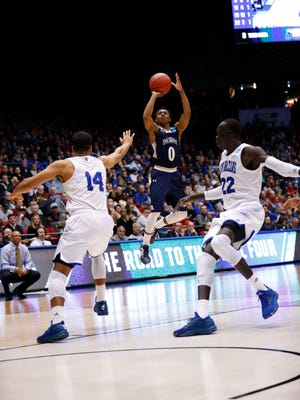 Mount St. Mary's Mountaineers guard Junior Robinson (0) shoots the ball over New Orleans Privateers forward Erik Thomas (14) in the second half in the first four of the 2017 NCAA Tournament at Dayton Arena.