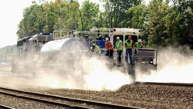 NJ Transit's AquaTrack system uses two high-pressure pumps to dispense water to clear leaves from its tracks.