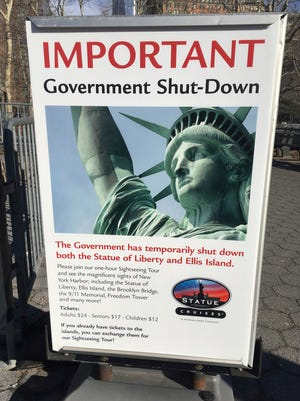 Sign at Ellis Island ferry to Statue of Liberty, Jan. 20, 2018, New York.