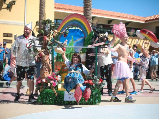 """Date Palm Country Club competes in the bed race with a """"Wizard of Oz"""" themed entry during the 2017 Cathedral City LGBT Days."""