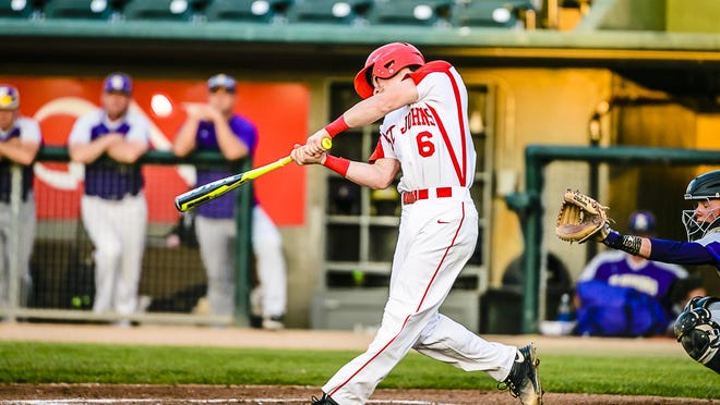 Parker Ackerman of St. Johns swings away during the Redwings' Diamond Classic first round game with Fowlerville Monday May 23, 2016 at Cooley Law Stadium in Lansing. KEVIN W. FOWLER PHOTO