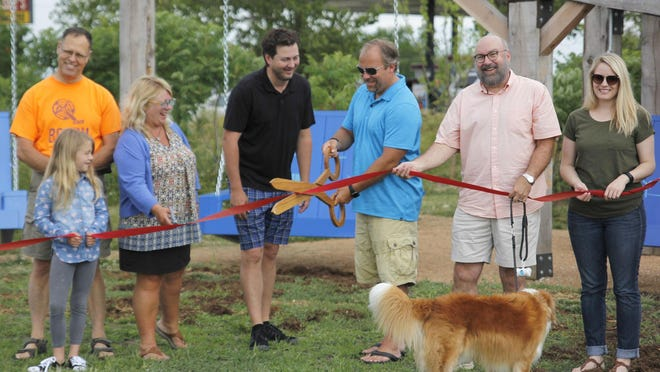 The ribbon cutting of the Porchswings and Fireflies.
