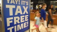 Bargain shoppers search for tax-free back-to-school deals