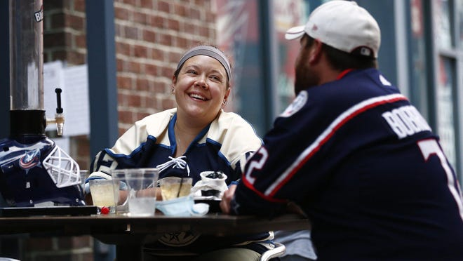 "The R Bar in the Arena District reserved tables for Blue Jackets fans to watch the third playoff game against the Toronto Maple Leafs on Thursday. Sarah Farr and her husband, Justin, traveled from Covington, Kentucky, to watch the playoffs at The R Bar. ""I live for sports,"" Justin Farr said. ""These watch parties sort of make you feel like you're there live."""