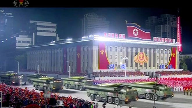 In an made from video broadcasted by North Korea's KRT, a military parade is held to mark the 75th anniversary of the country's ruling party in Pyongyang on Saturday.