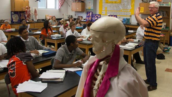 Mansfield Senior High School biology teacher Brad Kentosh prepares a class for a quiz  Friday morning .