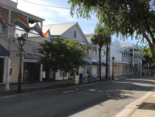 Storefronts in Key West, Fla., are boarded up in preparation