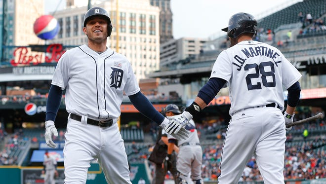 Detroit Tigers Ian Kinsler, left, and J.D. Martinez celebrate a home run against the Minnesota Twins on May 16, 2016, in Detroit.