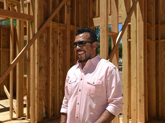 """Project manager Eugenio """"Henio"""" Medina stands inside a two-story house under construction in Reno, Nevada on June 23, 2017. Medina, co-owner of C&E Builders, immigrated to the U.S. from Mexico."""