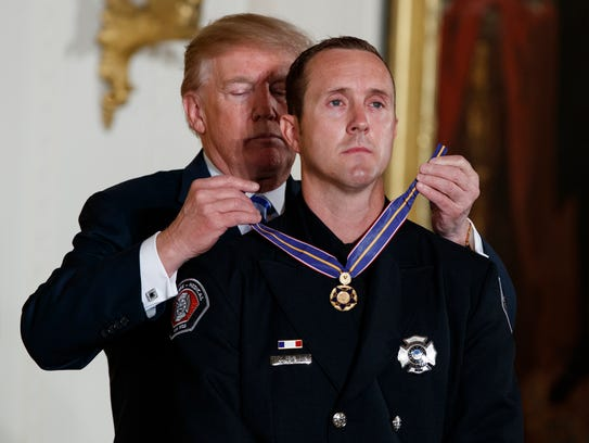 President Donald Trump presents the Public Safety Medal