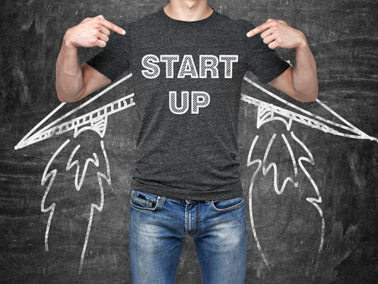 businessman is pointing in ' start up '