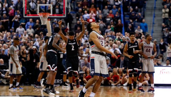 Connecticut Huskies guard Jalen Adams (2) reacts after missing a shot at the buzzer against the Cincinnati Bearcats in the second half at XL Center. Cincinnati defeated UConn 58-57.
