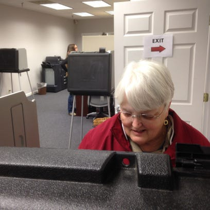 Karon Robinson casts her ballot for the March 1 presidential
