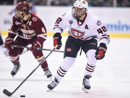St. Cloud State's Blake Winiecki skates with the puck