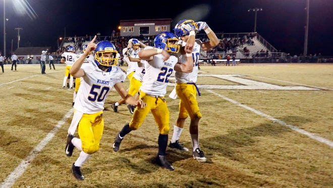 DCA's Max McConnell (50), Houston Troup (22) and Tyler Francis (40) celebrate after defeating Davidson Academy 27-21 on Friday.