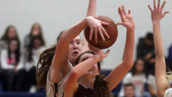 Eastchester's Fiona Teahan blocks a shot by Harrison's