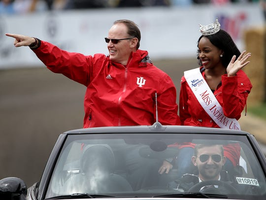 IU football head coach Tom Allen and Miss Indiana University Aniyah Birdsong wave to the fans during the opening ceremonies before tthe Little 500 at Armstrong Stadium on the campus of Indiana University in Bloomington.