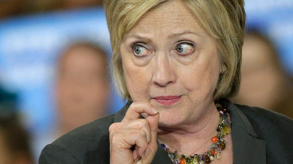 Democratic presidential candidate Hillary Clinton gestures