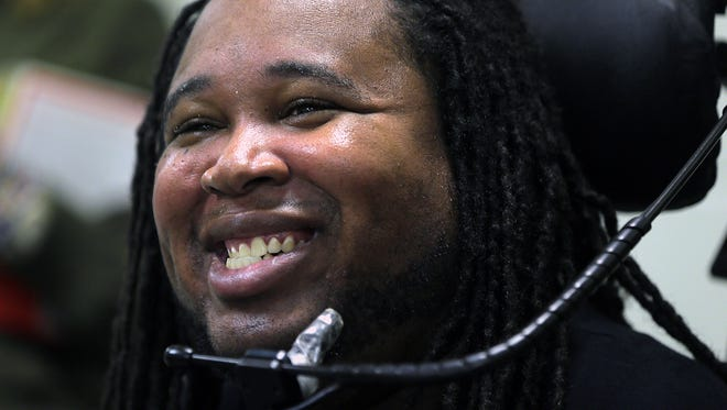 Eric LeGrand, a former Rutgers football player who became paralyzed while making a tackle in 2010 and wrote the book Believe: My Faith and the Tackle That Changed My Life, speaks to students at Jefferson Township High School in Oak Ridge, NJ Thursday, October 20, 2016.