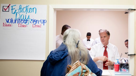 Chyrl Willis, of Milbrook, Ala., is signed in by Democrats Senate nominee Doug Jones to volunteer at the Doug Jones  Montgomery campaign office on Wednesday, Nov. 29, 2017, in Montgomery, Ala.